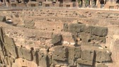 flavian : Roman Colosseum, day. Ancient landmark and people.
