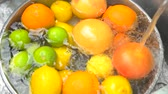 citrus fruit recipes : Heap of fresh citrus fruits under tap water, top view. Water splash on orange, top view close up. Stock Footage