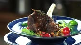 braised dishes : Lamb shank and ratatouille. Cooked meat with vegetables.