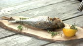fáklya : Fish preparation, culinary torch. Dorado with herbs and lemon.