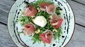rúcula : Burrata cheese salad. Tasty dish, arugula and prosciutto.