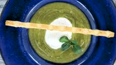 spinach : Spinach cream soup, poached egg. Healthy dish close up. Stock Footage
