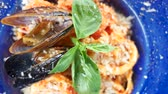 mediterranean mussel : Pasta dish close up. Mussel and basil leaf. Stock Footage