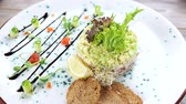 ringa : Herring tartare with fresh lettuce. Tasty restaurant food.