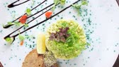 ringa : Tartare top view. Chopped salad and toasts.