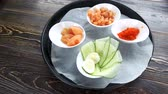 cucumber soup : Natural food ingredients in bowls. Sliced cucumber, egg and salmon. Stock Footage