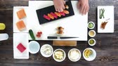 seafood recipe : Cooking table, sushi. Hands of chef, japanese dish. Stock Footage
