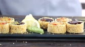 와사비 : Sushi garnished with chopped pistachios. Unagi maki rolls close up. 무비클립