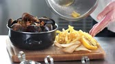 boiled potato : Mussels and fries. Food on a wooden board.