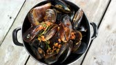 mexilhões : Steamed mussels in white wine. Cooked clams top view.