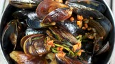 mussel dish : Steamed mussels with vegetables. Cooked clams with rosemary.