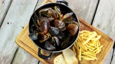 mollusk : Mussels with toasts and fries. Restaurant meal top view. Stock Footage