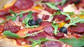 pizza restaurant : Delicious Italian pizza. Sausages arugula and olives. Stock Footage