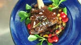 braised dishes : Lamb shank top view. Meat with vegetables and sauce.
