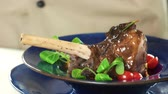braised dishes : Cooked meat close up. Lamb knuckle, sauce and spinach. Stock Footage