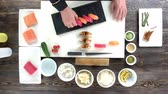 tuňák : Hands of chef, sushi. Cooking table, traditional japanese food.