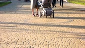 булыжник : 17.09.2017 - Kyiv, Ukraine. Baby carriages in the park. Cobblestones surface. Walking strolling people.