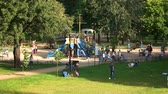 wesołe miasteczko : Ukraine, Kiev 17.09.2017. Outdoor playground in the park. Kids and their parents in the summer park.