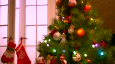 christmas angel : New Year tree with shimmering lights. Shiny Christmas decorations hanging on branches of the New Year tree. Merry Christmas and happy New Year. Stock Footage