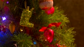 christmas tree ornament : Beautiful red toys on New Year tree. Beautifully decorated with various toys and blinking lights Christmas tree. Merry Christmas and happy New Year.