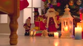 presentes : Christmas gifts and decorations on wooden floor. Christmas and New Year celebration. Christmas holiday scene.