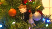christmas tree ornament : Angels and balls hanging on New Year tree. Christmas tree with blinking lights and beautiful ornaments. Beauty of New Year decor. Stock Footage