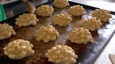 kitchen brushes : Chef glazing raw dough with yolk. Fresh dough on tray ready for baking. Baking cookies concept.