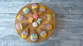 perník : Cookies on wooden background, top view. Biscuits with colorful icing. Delicious organic pastry. Dostupné videozáznamy