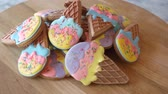 icecream : Pile of cookies with icing on wooden board. Colorful decorated cookies in a shape of ice cream. Healthy sweets for kids.