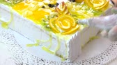 orange jelly : Cake decoration with pastry syringe. Confectioner decorating cake with white whipped cream. Fruit pastry recipe. Stock Footage