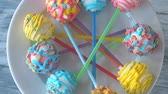 lolipop : Fresh and tasty cake pops on plate. Glaze with sprinkles. Beautiful design of sweets.
