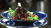 braised dishes : Roasted lamb knuckle and ratatouille. Tasty food, meat with vegetables. Stock Footage