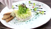 ringa : Herring tartare close up. Chopped fish and vegetables. Stok Video