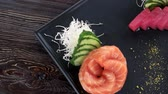 calorias : Sashimi, ginger and wasabi. Japanese dish top view.
