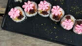 abacate : Maki sushi top view. Rice, caviar and cream cheese.