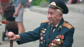 gratidão : 09.05.2018, Ukraine, Kiev. Senior grandpa with medals. World war veteran with cane stick.