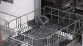 Woman using dishwasher at home. Modern appliance for dishes cleaning. Reasons to buy dishwasher. Vídeos