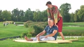 masażysta : Relaxed man receiving Thai massage. Traditional Thai massage outdoor. Relaxation and recreation concept.