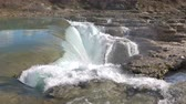 сумма : Water falls down a waterfall. Big amount of water falling over a rocky edge. Стоковые видеозаписи