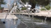 гейзер : Slow motion of water in a small fountain in a close-up Стоковые видеозаписи