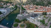 madármegfigzelés : Flying above the old town of Kotor in Montenegro. Shooting from height, aerial view, aerial photography. Slow flight over the city. Roof city Stock mozgókép