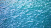 наводнение : Close up of disturbed blue ocean water surface. Slow motion