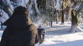Happy couple playing snowball fight and having fun in snow in winter forest Archivo de Video