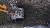 Up close view of excavator digging into the ground