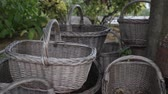 Empty harvest baskets stacked under the tree Wideo
