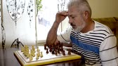 conceptual : Senior playing chess Stock Footage