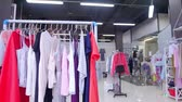 mannequin : Interior of fashionable womens clothes store with clothes racks & mannequins