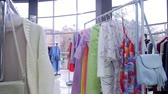 butik : Interior of fashionable womens clothes store with clothes racks & mannequins