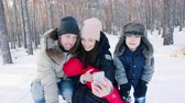 insan grubu : Family makes selfie in the winter forest