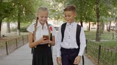 школьница : Girl and Boy with a knapsack goes to school